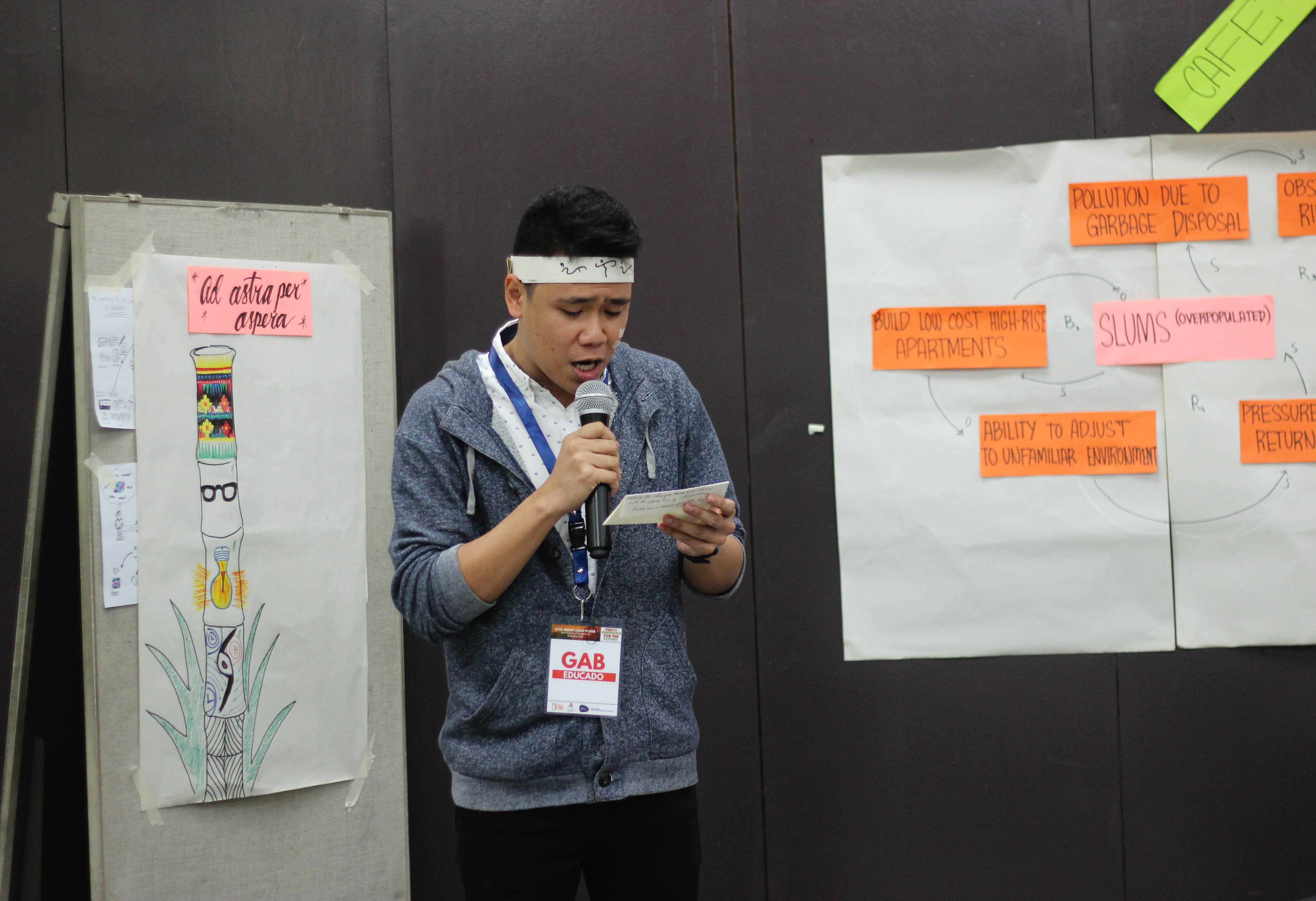 Gab Educado, a fellow, presenting his group's outputs for a collaborative activity.