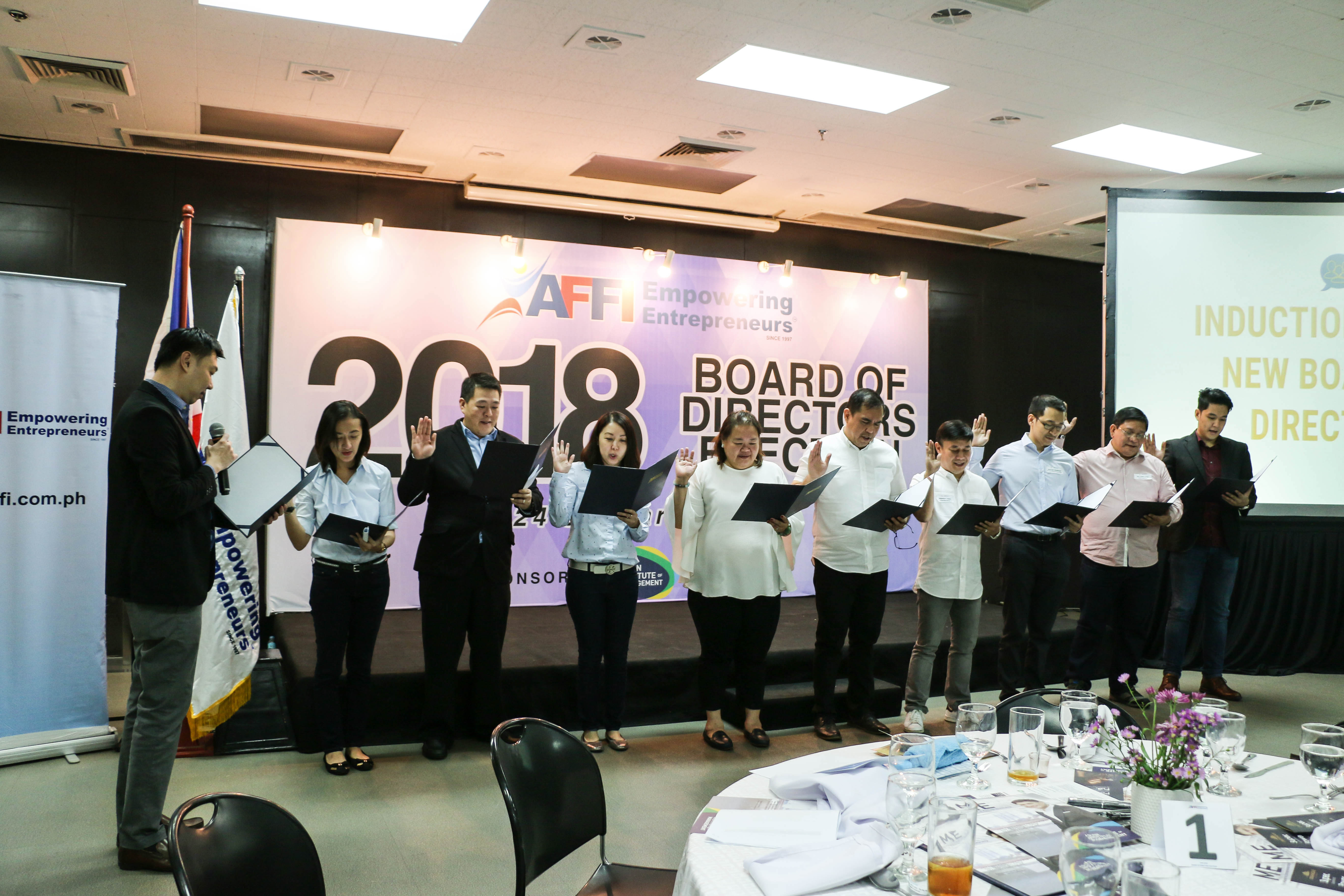 Outgoing AFFI President John Chung inducts the 2018 Board of Directors