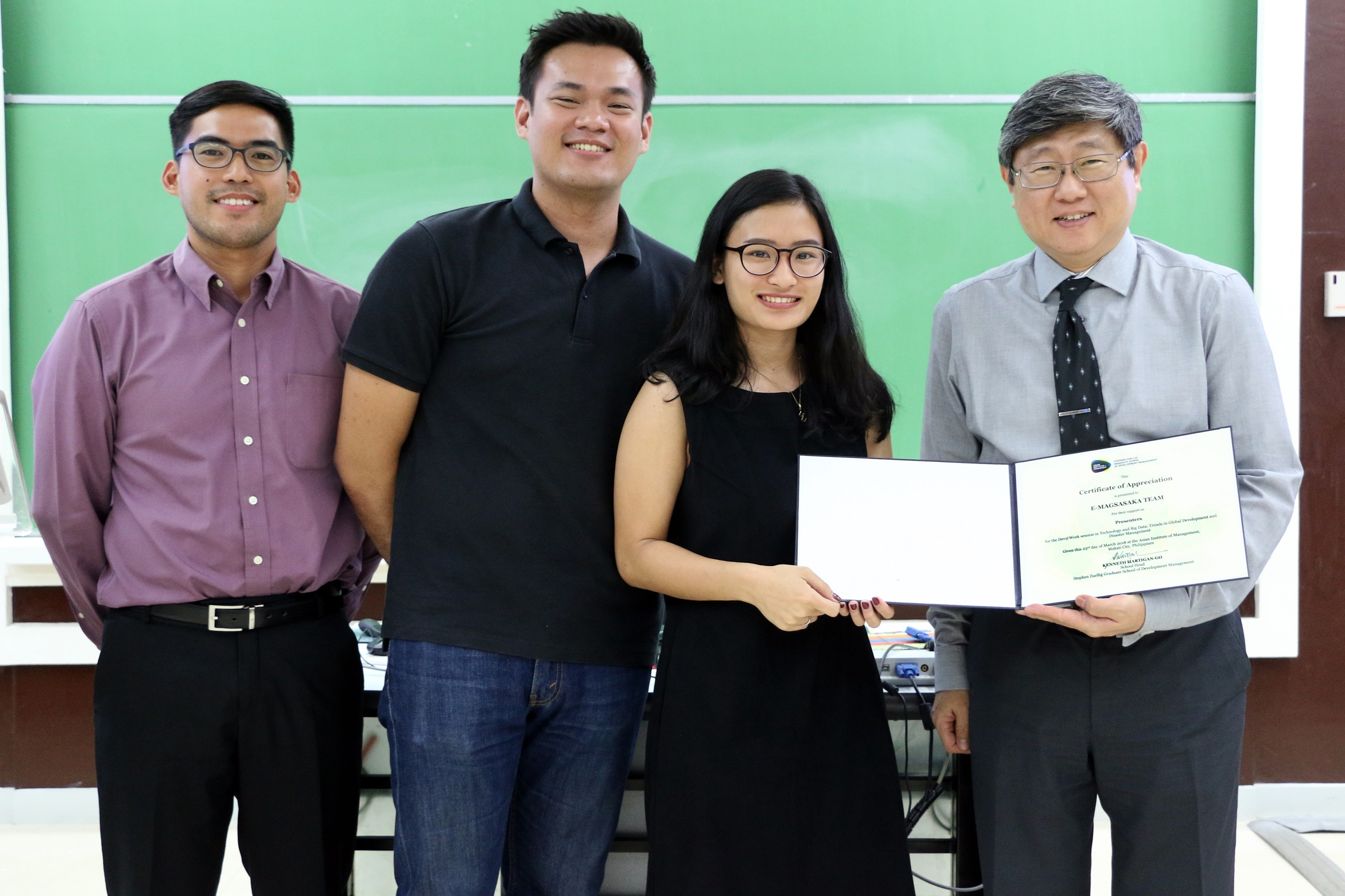 (From left) Jose Gabriel Dimalanta, Aaron David, Aiah Sarmiento, and Prof. Kenneth Hartigan-Go at the end of the Dev@Work session.