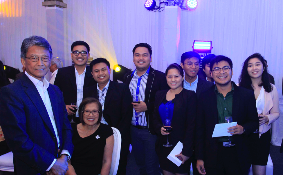 MIB students join tech luminary Dado Banatao and his wife, Maria Banatao.