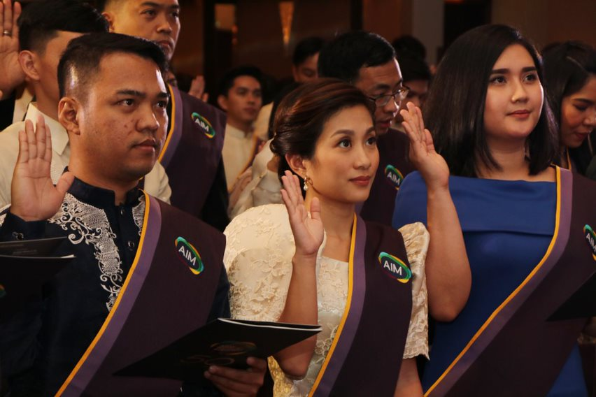 Graduates taking their oaths during their induction to the AIM Alumni Association
