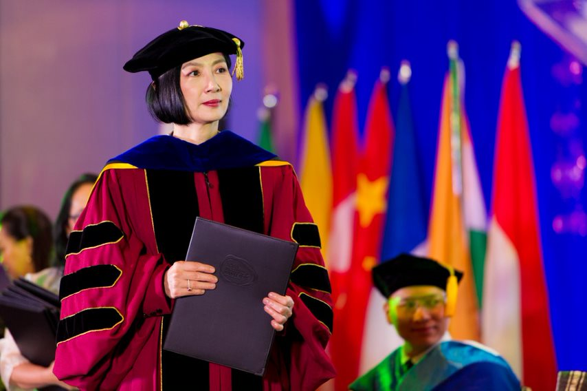 President and Dean of AIM, Jikyeong Kang, PhD, awarding diplomas to the graduates