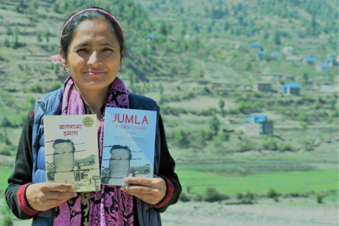 "Radha Paudel with her book, ""Khalangama Hamala"", English title, ""JUMLA: A Nurse's Story"""